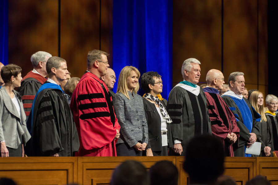 Elder and Sister Bednar, President and Sister Clark, President and Sister Uchtdorf, Elder Oaks, and Elder Holland on the stand during the Processional. Photo by Erik Hill.