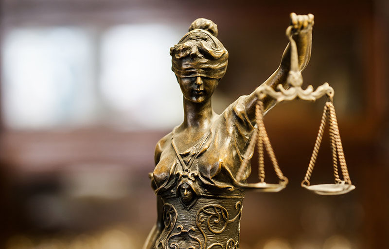 blind justice woman statue shutterstock