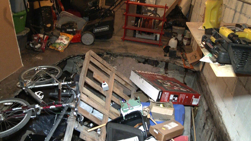 local family discovers hidden room after sinkhole opens in garage