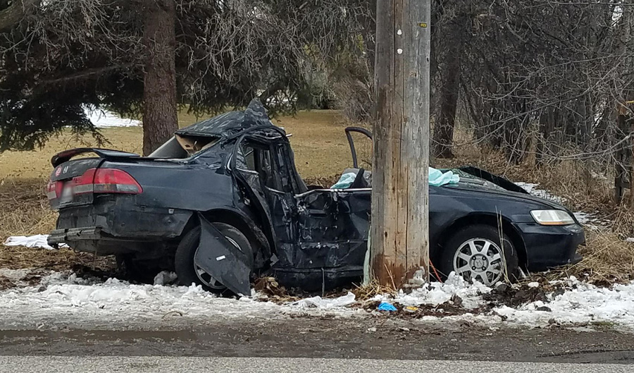 Two people extricated after car crashes into power pole
