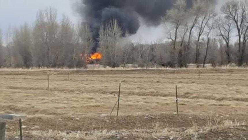 Log cabin fully engulfed in flames near Rigby