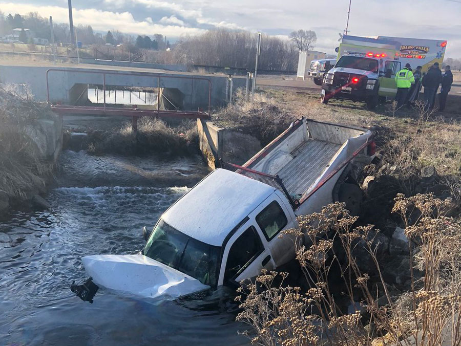 UPDATE: Truck ends up in canal after two-vehicle wreck