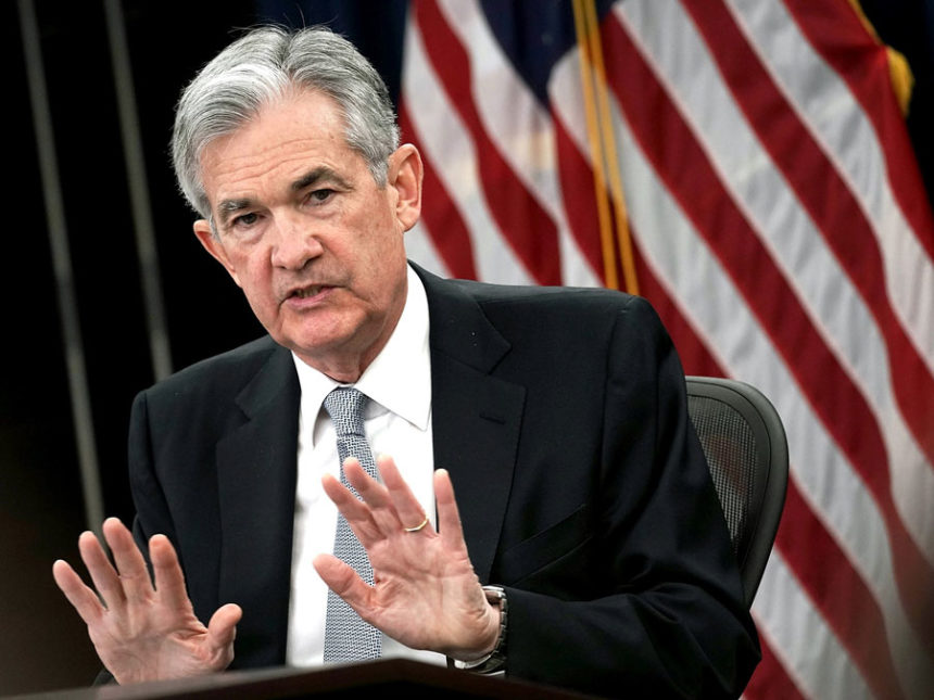 'Plain English' Powell Praises U.S. Economy After Rate Hike