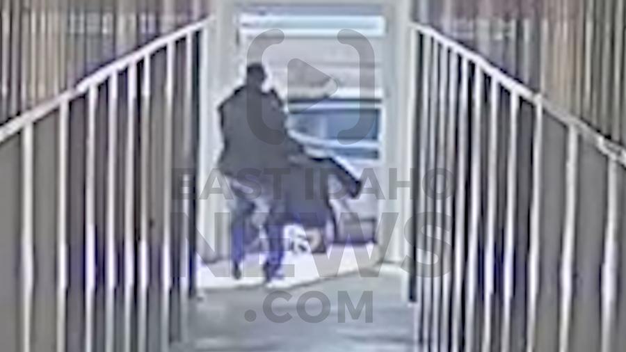 man carries seat