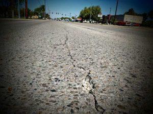 cracked asphalt in front of ITD building