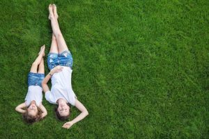 mother and daughter on lawn