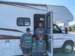 Ryder Klop, 10, and his family, mother Brittany, father A.J. and Jayeden, posing in front of a motorhome rented by Make-A-Wish for a family trip to Yellowstone.