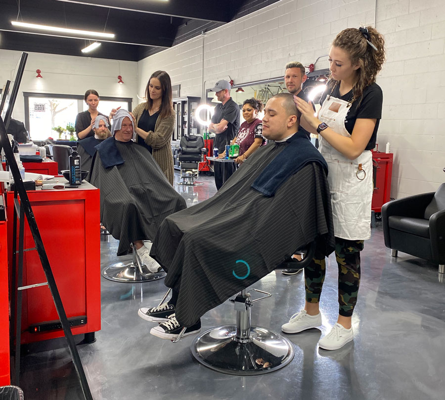 students cutting customers' hair
