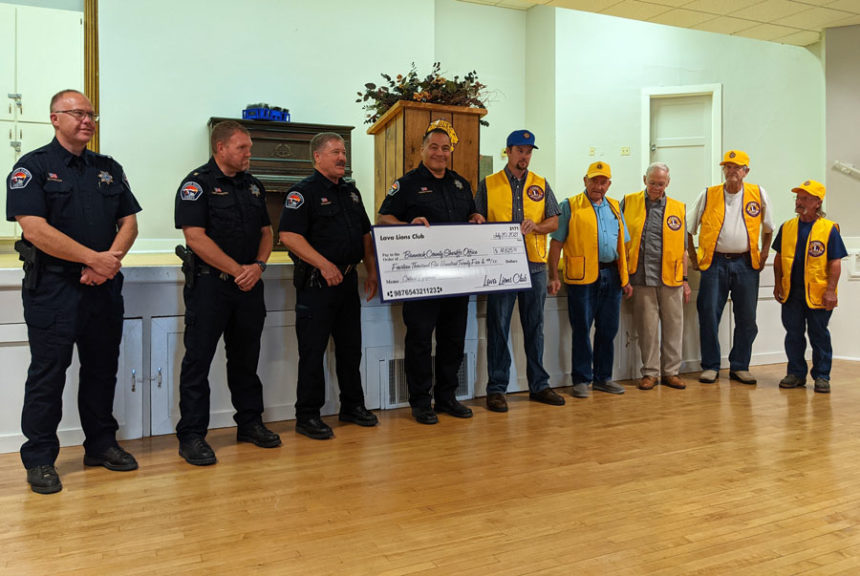 Lava Hot Springs Lions Club present Bannock County Sheriff with check for $14,625.