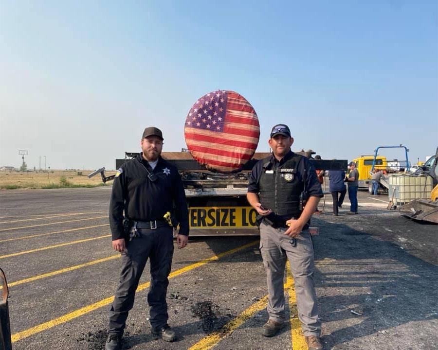 Clark county deputies next to flag cover