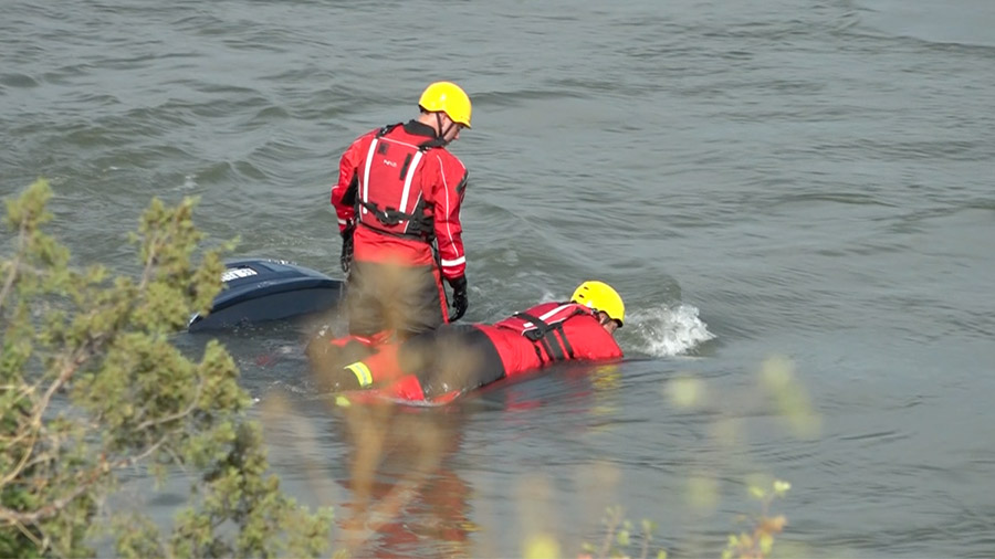 Firefighters in the water
